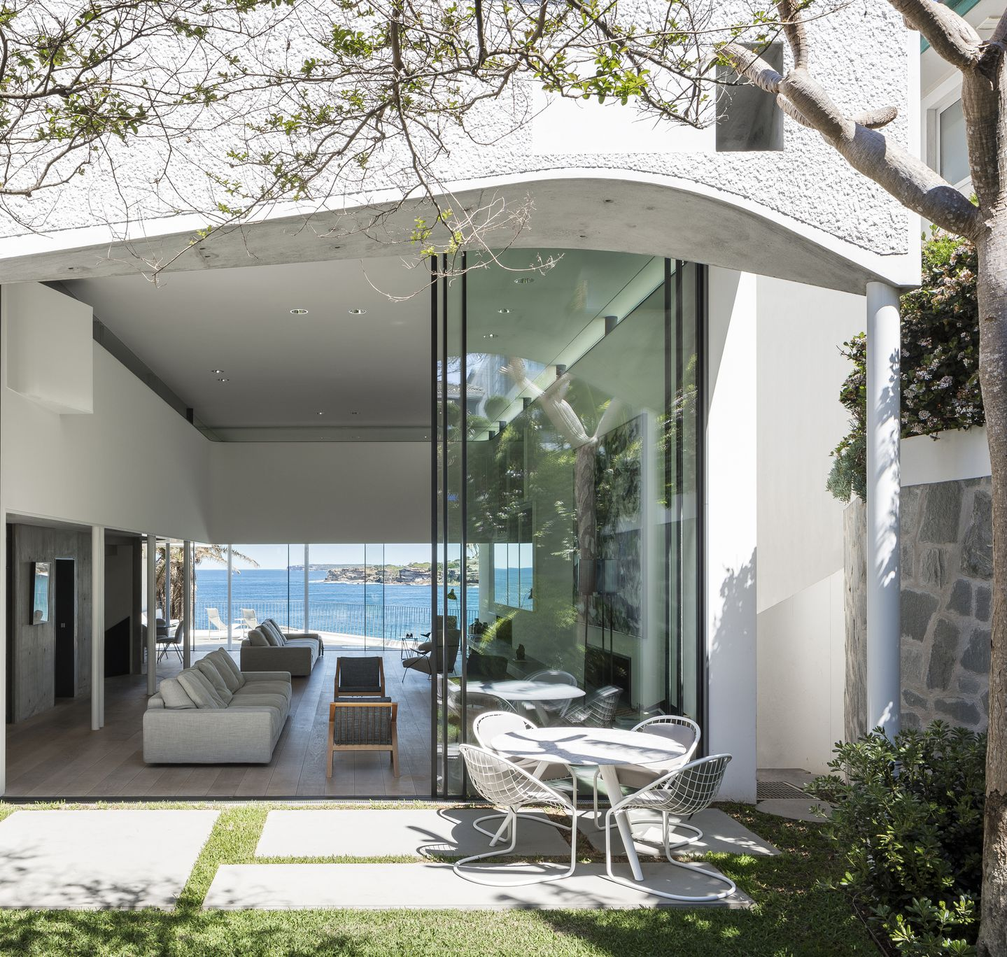 Sculptural concrete beachfront house located in Tamarama along the Bondi to Coogee walk designed by Durbach Block Jaggers Architects.