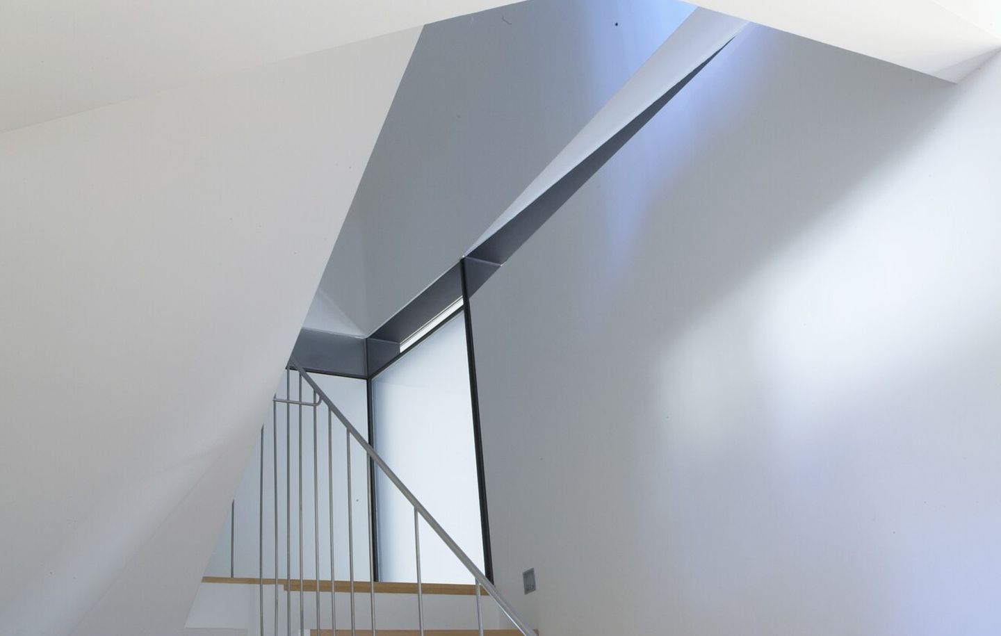 Curved white plastered stairwell with fine steel handrail and windows from house in Bellevue Hill Sydney designed by Durbach Block Jaggers Architects