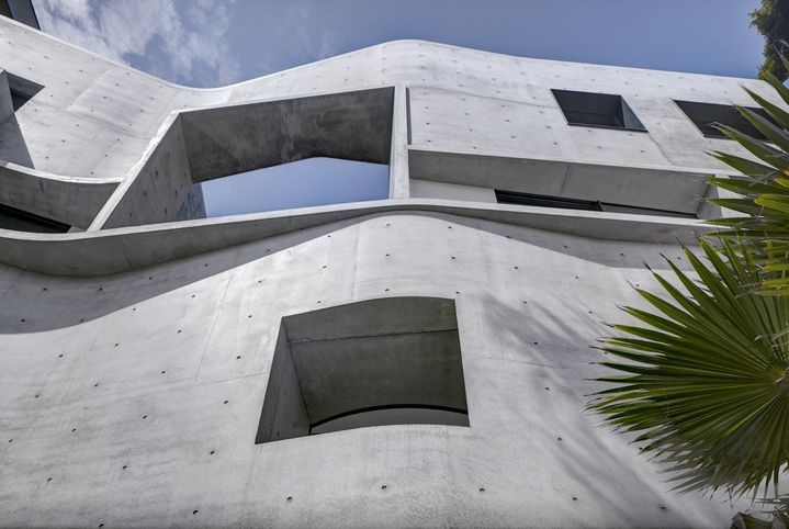 Raw sculptural concrete brutalist house on located on the Sydney harbour front in Point Piper designed by Durbach Block Jaggers Architects.
